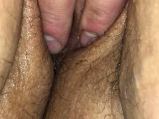 rubbing her nice wet pussy
