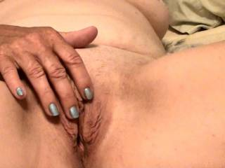 Photo of me playing with my pussy and clit right before we got busy. He ate that pussy like a man possessed and made me cum several times. Would you eat my old pussy?