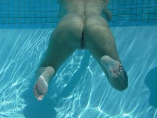 Relaxing in the swimming pool at home. You can just swim across and stick your big cock inside me now.