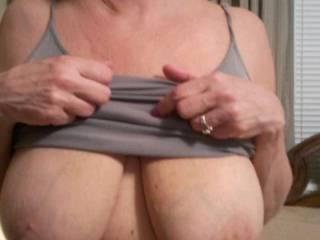 Doing a little boobie flash