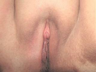 My wife showing off her chubby pussy after having a go with a clit pump. She\'ll cum in no time with some firm licking - who\'d like to go first?