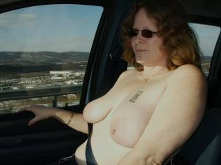 My wife showing off her tits to truckers on a raodtrip.