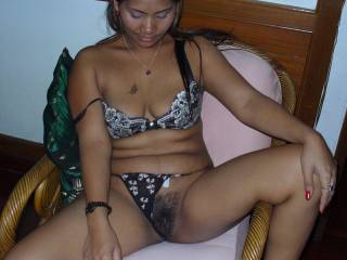 Love to bury my head down between her legs, love her hairy pussy.