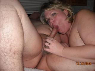 She was staring at her hubby as he asked her if she was enjoying sucking my cock...she just moaned and sucked me harder