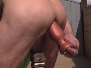 """Out on my deck slipping my 18"""" anal snake into my tight butt hole ! Almost got it all in.  Wish i had a perv buddy to watch me and maybe even help slide it in !"""