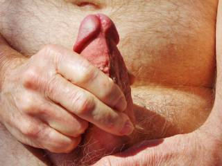 In the midst of a wonderful photoshoot, my photographer zoomed in for a closeup while I  was caressing my erect cock.