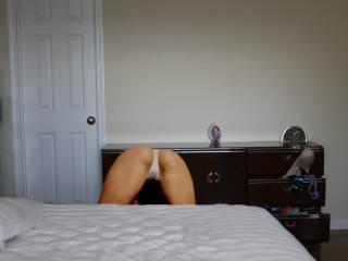 Looking for her stockings,  my wife was prepping for a night out with a guy. I couldn\'t resist taking a shot of her new Victoria Secret thong knowing they will be soaked with cum when she\'s back.