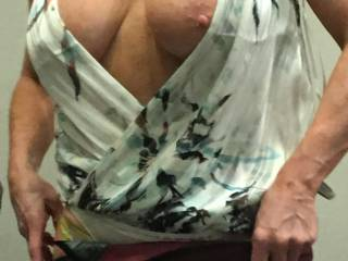 Is this top sexy folks? She never wears a bra so her tits often end up outside her top.