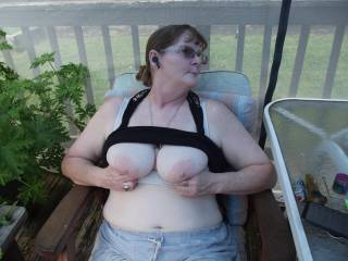 A quick flash of some big tits out on the deck taking a break from the yard work