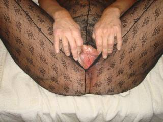 holding her pussy open for all to see!