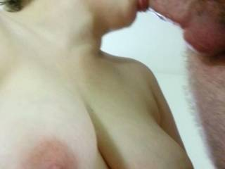She looks great sucking your cock and her tits are fantastic.