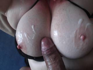 Another load all over my oiled up big tits.