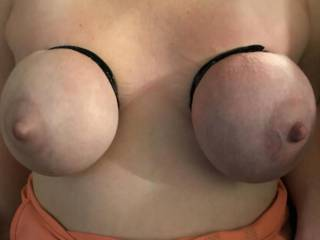 Another pic of Kiki's tits taped up! Do you think she is as sexy as I do? Do you want to play with her hard taped up tits?