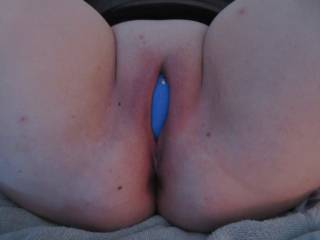 Wife's freshly shaved pussy with her We Vibe vibrator planted firmly in position. She came like crazy!!