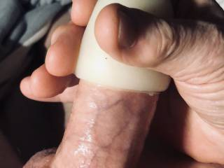 Masturbating with a cock sleeve.