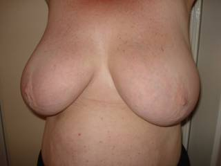 Mmmmm love to cover those gorgeous breasts with cum and then lick them clean