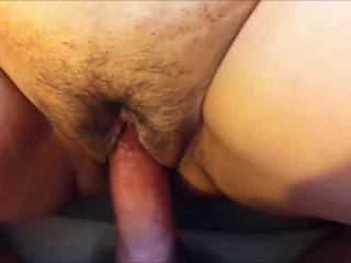 My cum is ready to explode from my hard, throbbing cock deep inside her pussy.