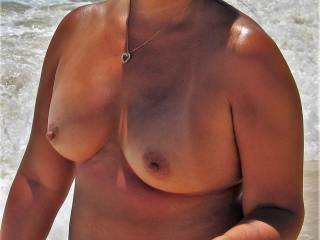 walking on the beach topless