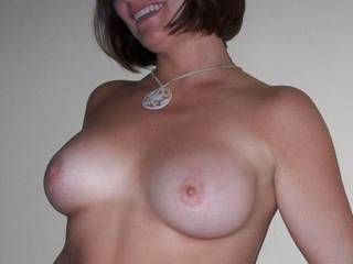 Love the smile. I would love to shoot a huge load all over your titties and watch my cum drip of your delicious nipples.