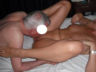 Our swinger friend is very good at eating out my pussy.  I was playing with my nipples as he worked his magic with his tongue.