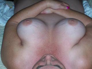 I'll lick, kiss, and suck on those beauties. Now tilt your head back so I can fuck your mouth, before I wrap those titties around my hard cock. You can lick and suck my balls as I fuck your tits until I cum all over them...