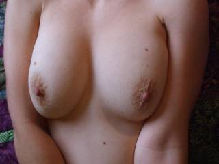 I'd love to massage, suck them, slide my cock between them, bit your nips, and shoot my cum all over those sexy breasts! Mmmm