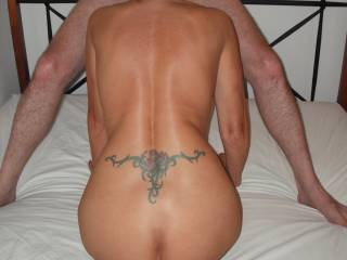 Check out the lovely shape of my wife\'s back and ass, when she sucked our swinger friend\'s cock. It looks like a beautiful cello or a violin.