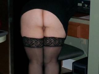 We wouldn't be suprised, but we'd surely love it.  Very nice ass, beautiful pussy, and sexy legs in those lace-top stockings.