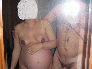 your body is so sexy looking when pregnant!  nice to see the hot cock and potent balls that knocked you up!  you both have sexy bodies....great pic!