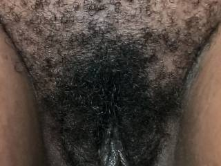I love hairy natural pussy. Notice the long labia, very sexy