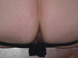 Black lacy panties on their way down.