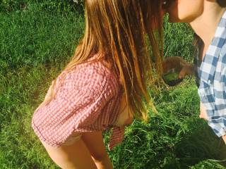 The ladies kissing in the field.