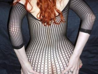 WOW!! Such a sexy woman, gorgeous cream skin, flame red hair and ass that could make grown men cry!!