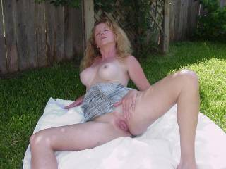 Wife spreading her pussy outside.