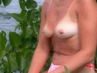 Posing topless outdoors