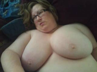 My beautiful wife and her humongous tits, gazing upward at nothing.