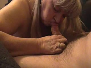 chubby milf sucking cock. Love her tits.....