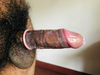 black cock, pink condom. who wanna get fucked?