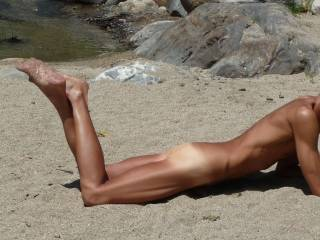 Just lying on the beach feeling the sands caressing my erect cock.  You just have to imagine what is hiding.