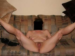 Spread wide open on the couch waiting for a nice hard cock!