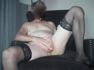 Showing off my ne stockings and small cock.  See anything you like?