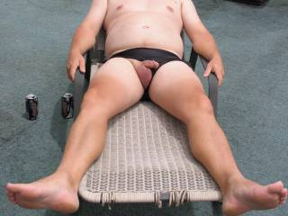 Aaahhh, the outdoors.  The sunshine, a chair and a cock that needs some attention. Care to assist?