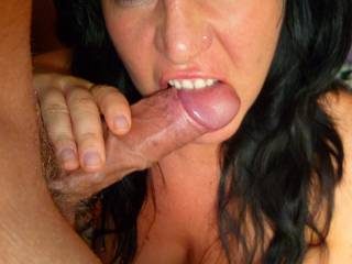 That is an amazing pic of this hottie hungry for cock.  Her eyes are very sexy, not to mention the rest of her pretty face and her gorgeous body.  Very nice, thick, long cock too.  We're not sure who's luckier here, but we bet that you both are loving every second of that action.  Awesome pic.