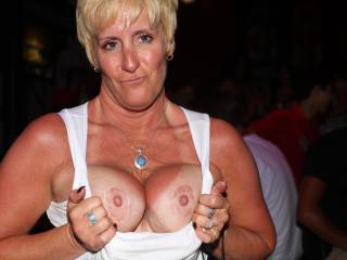 I met this 45 yo milf on her last night in Cancun, outside of flashing her tits, some upskirt pics and pulling off her bra in the middle of the club district and giving it to me I could not talk her into missing her flight. Oh well...i tried...