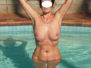 Wow, what a sizzling hot body. I'm surprised there isn't steam coming off that pool water.