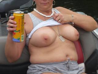 I wish i was on that boat with you sweetie it would be awsome to ride with you and grab a handful of those amazing suckable tits.