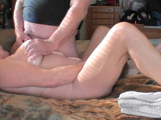 I have my wand vibrator between my legs while he is rubbing his cock on my one tit while squeezing my other tit.  Does it look as good as it feels