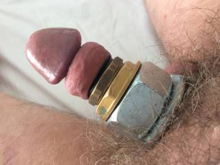 Cyborg cock wearing rubber and metal rings