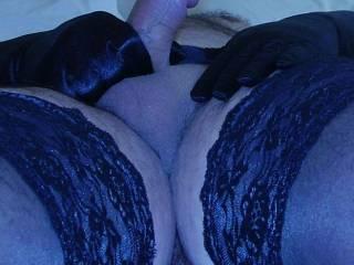 Lying back and stroking my hard cock.  Velvet feels so nice.