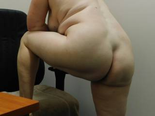another of the naughty secretary showing her wares in the office